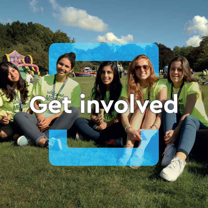 Get involved - image of girls sitting on the grass